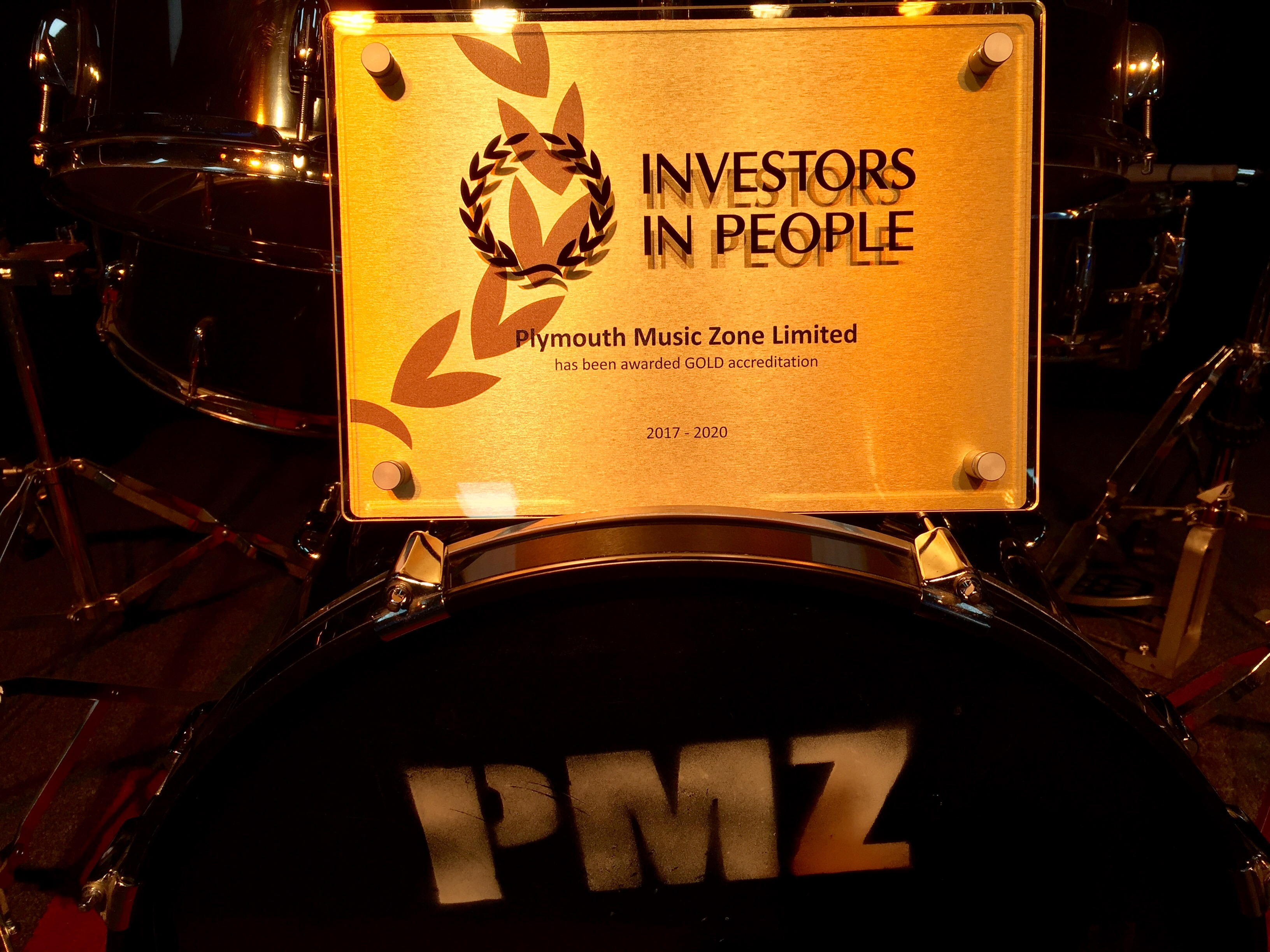 Gold Investors in People Award on drum